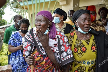 Stock Picture of Mourners react during the funeral of Sarah Onyango Obama, the step-grandmother of former US president Barack Obama, at her home in Kogelo in western Kenya 30 March 2021. Ninety-nine-year-old Mama Sarah, as she was known, died 29 March 2021 in a small village on the shores of Lake Victoria and was a philanthropist who promoted education for girls and orphans.