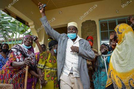 Mourners react during the funeral of Sarah Onyango Obama, the step-grandmother of former US president Barack Obama, at her home in Kogelo in western Kenya 30 March 2021. Ninety-nine-year-old Mama Sarah, as she was known, died 29 March 2021 in a small village on the shores of Lake Victoria and was a philanthropist who promoted education for girls and orphans.