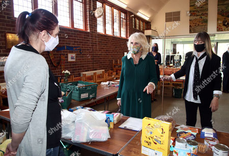 Camilla Duchess of Cornwall talks to Tracey Cheesman (left) during a visit to Fitzjohn's Food Bank and the Lewes Open Door charity at Christ's Church in Lewes, East Sussex.