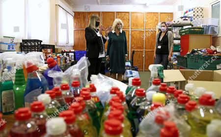 Camilla Duchess of Cornwall with Chairman Roz Bassford (left) and Tracey Cheesman (right) during a visit to Fitzjohn's Food Bank and the Lewes Open Door charity at Christ's Church in Lewes, East Sussex.