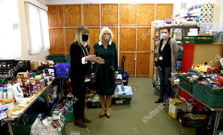 Stock Image of Camilla Duchess of Cornwall with Chairman Roz Bassford (left) and Tracey Cheesman (right) during a visit to Fitzjohn's Food Bank and the Lewes Open Door charity at Christ's Church in Lewes, East Sussex.