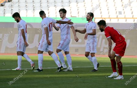 Iran's Sardar Azmoun (C) celebrates with teammates after scoring the 2-0 lead during the International Friendly soccer match between Iran and Syria at the Azadi stadium in Tehran, Iran, 30 March 2021.