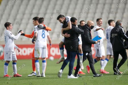 Cyprus' players celebrate at the end of the World Cup 2022 group H qualifying soccer match between Cyprus and Slovenia at GSP stadium in Nicosia, Cyprus