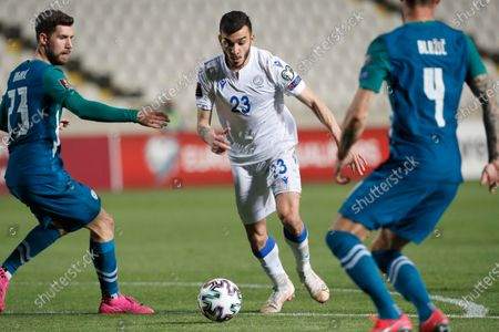 Cyprus' Ioannis Pittas, centre, scores his side's opening goal during the World Cup 2022 group H qualifying soccer match between Cyprus and Slovenia at GSP stadium in Nicosia, Cyprus