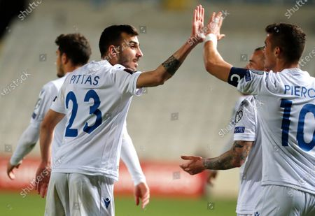Cyprus' Ioannis Pittas celebrates after scoring his side's opening goal during the World Cup 2022 group H qualifying soccer match between Cyprus and Slovenia at GSP stadium in Nicosia, Cyprus