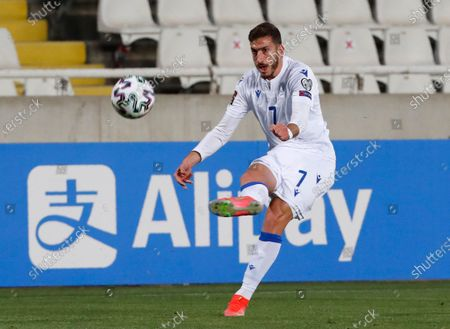 Cyprus' Minas Antoniou kicks the ball during the World Cup 2022 group H qualifying soccer match between Cyprus and Slovenia at GSP stadium in Nicosia, Cyprus