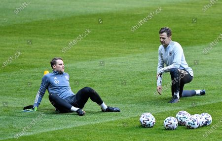 Keeper Manuel Neuer, left, exercises with team manager Oliver Bierhoff during a training session of the German national soccer team prior the World Cup 2022 group J qualifying soccer match against North Macedonia in Duesseldorf, Germany, . AP Photo/Martin Meissner