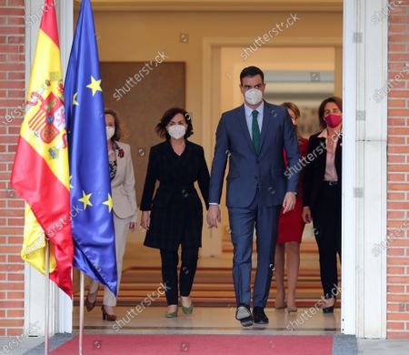 Spanish Prime Minister Pedro Sanchez (C) arrives to deliver a press conference next to the four Spanish Deputy Prime Ministers, Yolanda Diaz (2-R), Carmen Calvo (2-L), Nadia Calvino (L) and Teresa Ribera (R), at Moncloa's Presidential Palace, in Madrid, central Spain, 30 March 2021, after his meeting with Spain's King Felipe VI to brief him about the changes in the Government. Spanish second deputy Prime Minister, Pablo Iglesias, resigned from his post in order to run for Madrid's regional Presidency in the oncoming regional elections, 04 May 2021, which caused the upgrade of Spanish Economy Minister Nadia Calvino into his place. Labor Minister Yolanda Diaz is now the third deputy Prime Minister, and former Secretary of State for 2030 Agenda, Ione Belarra, will act as the new Social Rights Minister.