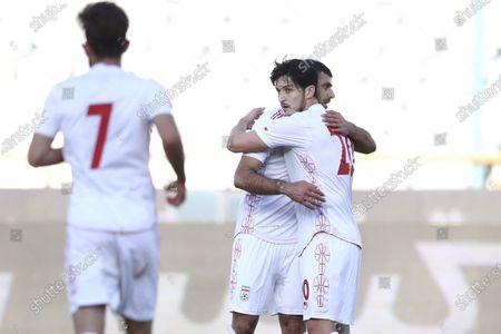 Mehdi Taremi of Iran with Sardar Azmoun celebrates after scoring his sides second goal