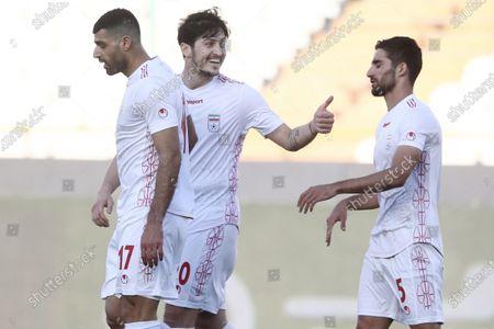 Mehdi Taremi of Iran with Sardar Azmoun and Milad Mohammadi celebrates after scoring his sides second goal