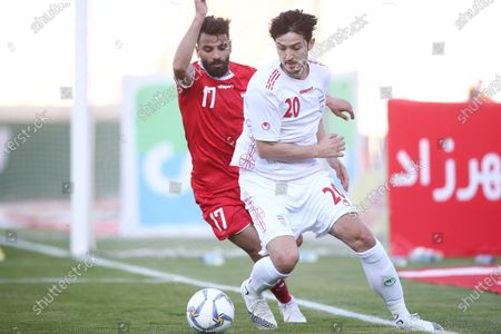 Sardar Azmoun of Iran challenged by Youssef Al Hamawil of Syria