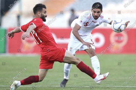 Stock Image of Milad Mohammadi of Iran challenged by Mohammed Osman of Syria