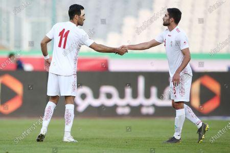 Vahid Amiri (L) and Milad Mohammadi (R) of Iran