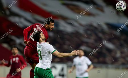 Qatar vs Republic of Ireland. Ireland's Shane Long with Boualem Khoukhi of Qatar