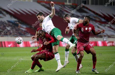 Qatar vs Republic of Ireland. Irelands Shane Long and Troy Parrott with Abdulkarim Hassan and Abdulaziz Hatim of Qatar