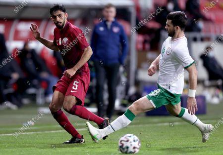 Qatar vs Republic of Ireland. Ireland's Shane Long with Tareq Salman of Qatar
