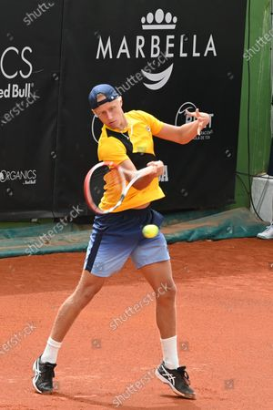 Stock Image of Swedish player Leo Borg in action against Japan's Taro Daniel during their first round match at the Marbella Tennis Open tournament, in Marbella, southern Spain, 30 March 2021.