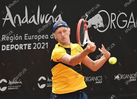 Stock Photo of Swedish player Leo Borg in action against Japan's Taro Daniel during their first round match at the Marbella Tennis Open tournament, in Marbella, southern Spain, 30 March 2021.