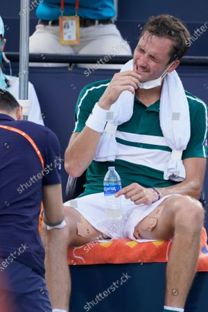 Daniil Medvedev of Russia, receives medical treatment on his knee during a match against Frances Tiafoe at the Miami Open tennis tournament, in Miami Gardens, Fla