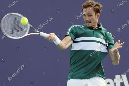 Daniil Medvedev of Russia, returns to Frances Tiafoe, during the Miami Open tennis tournament, in Miami Gardens, Fla