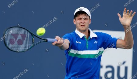 Hubert Hurkacz of Poland in action against Milos Raonic of Canada during their Men's singles match at the Miami Open tennis tournament in Miami Gardens, Florida, USA, 30 March 2021.