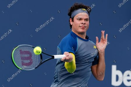 Milos Raonic of Canada in action against Hubert Hurkacz of Poland during their Men's singles match at the Miami Open tennis tournament in Miami Gardens, Florida, USA, 30 March 2021.