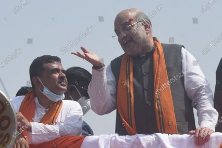Union Home minister Amit Shah during a road show in support of Suvendu Adhikari (L), the BJP candidate for Nandigram constituency, at Nandigram on March 30, 2021 in East Midnapore, India. Nandigram has now become a prestige battle for sitting chief minister Mamata Banerjee and her former lieutenant and now BJP candidate Suvendu Adhikari. Nandigram is the birthplace of the historic land movement that propelled Mamata Banerjee to power by dethroning the Left in 2011. To win what is now being seen as the biggest battle of Bengal, Mamata Banerjee has decided to camp in Nandigram for the next three days starting Sunday. Nandigram will vote in the second phase on April 1.