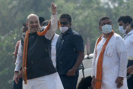 Union Home minister Amit Shah after a road show in support of Suvendu Adhikari (R), the BJP candidate for Nandigram constituency, at Nandigram on March 30, 2021 in East Midnapore, India. Nandigram has now become a prestige battle for sitting chief minister Mamata Banerjee and her former lieutenant and now BJP candidate Suvendu Adhikari. Nandigram is the birthplace of the historic land movement that propelled Mamata Banerjee to power by dethroning the Left in 2011. To win what is now being seen as the biggest battle of Bengal, Mamata Banerjee has decided to camp in Nandigram for the next three days starting Sunday. Nandigram will vote in the second phase on April 1.