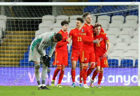 Wales goalkeeper Danny Ward, Neco Williams of Wales Joe Rodon of Wales, Ethan Ampadu of Wales and Joe Morrell of Wales celebrate at the end of the match