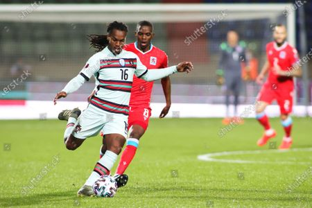 Portugal's Renato Sanches, left, vies for the ball against Luxembourg's Christopher Martins during the World Cup 2022 group A qualifying soccer match between Luxembourg and Portugal at the Josy Barthel Stadium in Luxembourg