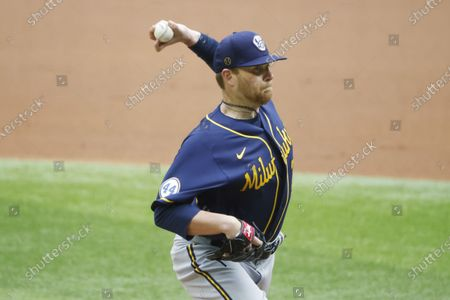 Milwaukee Brewers starting pitcher Brett Anderson pitches against the Texas Rangers during the first inning of a preseason baseball game, in Arlington, Texas