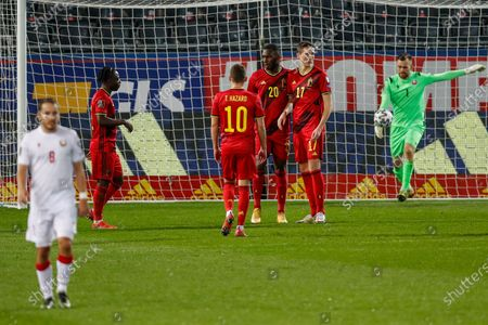 Belgium's Christian Benteke, third right, celebrates after scoring his side's sixth goal during a World Cup 2022 group E qualifying soccer match between Belgium and Belarus at the King Power stadium in Leuven, Belgium