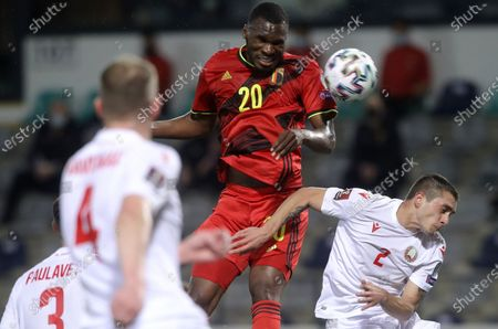 Belgium's Christian Benteke (L) in action against Belarus' Roman Yuzepchukh (R) during the FIFA World Cup 2022 qualifying soccer match between Belgium and Belarus in Leuven, Belgium, 30 March 2021.