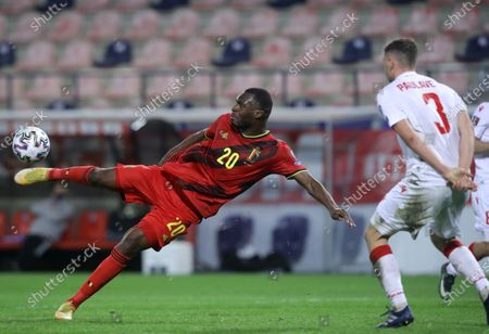 Belgium's Christian Benteke (L) in action against Belarus' Aleksandr Pavlovets (R) during the FIFA World Cup 2022 qualifying soccer match between Belgium and Belarus in Leuven, Belgium, 30 March 2021.