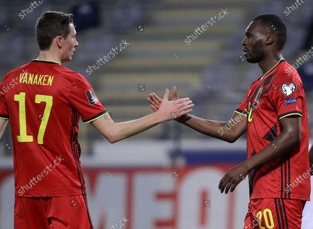 Belgium's Christian Benteke (R) celebrates with Hans Vanaken (L) after scoring the 6-0 during the FIFA World Cup 2022 qualifying soccer match between Belgium and Belarus in Leuven, Belgium, 30 March 2021.