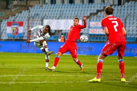 Portugal's Renato Sanches (L) in action against Luxembourg's Danel Sinani (C) during the FIFA World Cup 2022 qualifying soccer match between Luxembourg and Portugal at Josy Barthel Stadium in Luxembourg, 30 March 2021.