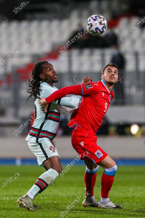 Portugal's Renato Sanches (L) in action against Luxembourg's Danel Sinani (R) during the FIFA World Cup 2022 qualifying soccer match between Luxembourg and Portugal at Josy Barthel Stadium in Luxembourg, 30 March 2021.