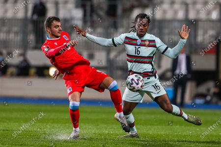 Portugal's Renato Sanches (R) in action against Luxembourg's Danel Sinani (L) during the FIFA World Cup 2022 qualifying soccer match between Luxembourg and Portugal at Josy Barthel Stadium in Luxembourg, 30 March 2021.
