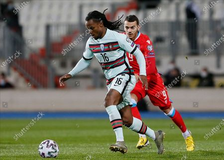 Portugal's Renato Sanches (L) in action against Luxembourg's Danel Sinani (R) during the FIFA World Cup 2022 qualifying soccer match between Luxembourg and Portugal in Luxembourg, 30 March 2021.