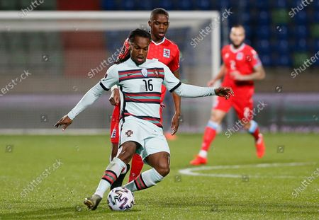 Portugal's Renato Sanches (front) in action against Luxembourg's Christopher Martins (back) during the FIFA World Cup 2022 qualifying soccer match between Luxembourg and Portugal in Luxembourg, 30 March 2021.
