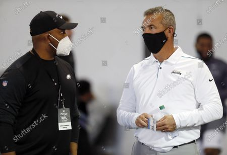 Jackson Jaguars coach and former Ohio State coach Urban Meyer talks with Eagles assistant Brian Johnson during an NFL Pro Day at Ohio State University in Columbus, Ohio