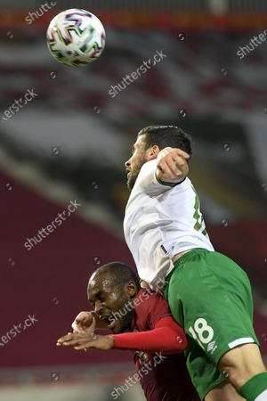 Shane Long of Ireland (R) in action against Abdulkarim Hassan of Qatar (L) during the friendly soccer match Qatar vs. Ireland friendly soccer match in Debrecen, Hungary, 30 March  2021.
