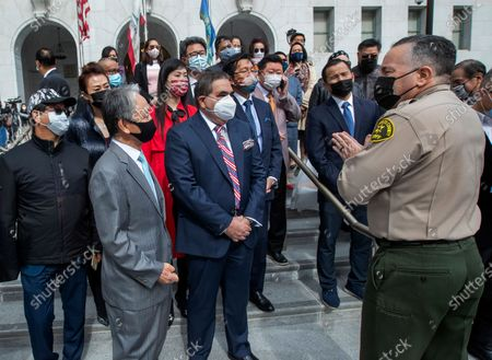 Los Angeles County Sheriff Alex Villanueva, right, standing in front of the Hall of Justice in downtown Los Angeles, talks with with members of local Asian community groups in a show of solidarity and support for the local Asian American and Pacific Islander community. Villanueva called for zero tolerance for hate crimes and incidents in L.A. County. 2nd from left is Kyung Jae Park, Counsul General of the Republic of Korea in Los Angeles and 3rd from left is Adnan Khan, Chairman, Council of Pakistan. (Mel Melcon / Los Angeles Times)