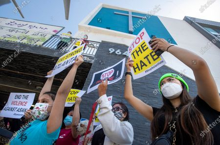 Olivia Lee, 24, right, joins members of the Korean American Federation of Los Angeles and their supporters during a press conference at Berendo Street Baptist Church in Los Angeles to denounce hate against Asian American and Pacific Islander communities. A car caravan, soon after, started from the church, located on Berendo St. in Los Angeles and made their way to Vermont Ave. and Olympic Blvd. (Mel Melcon / Los Angeles Times)