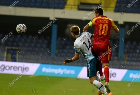 Norway's Julian Ryerson (L) in action against Montenegro's Stevan Jovetic (R) during the FIFA World Cup 2022 qualifying soccer match between Montenegro and Norway in Podgorica, Montenegro, 30 March 2021.