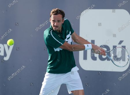 Daniil Medvedev  from Russia returns the ball to Frances Tiafoe from the USA in the fourth round of the Miami Open at Hard Rock Stadium in Miami Gardens, Florida on Tuesday, March 30, 2021.