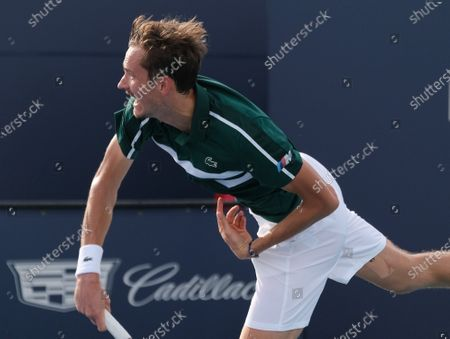 Daniil Medvedev from Russia serves to Frances Tiafoe from the USA in the fourth round of the Miami Open at Hard Rock Stadium in Miami Gardens, Florida on Tuesday, March 30, 2021.
