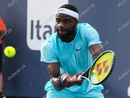 Frances Tiafoe from the USA  returns serve to Daniil Medvedev from Russia in the fourth round of the Miami Open at Hard Rock Stadium in Miami Gardens, Florida on Tuesday, March 30, 2021.
