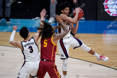 Gonzaga guard Aaron Cook, grabs a rebound over Southern California guard Isaiah White (5) during the first half of an Elite 8 game in the NCAA men's college basketball tournament at Lucas Oil Stadium, in Indianapolis