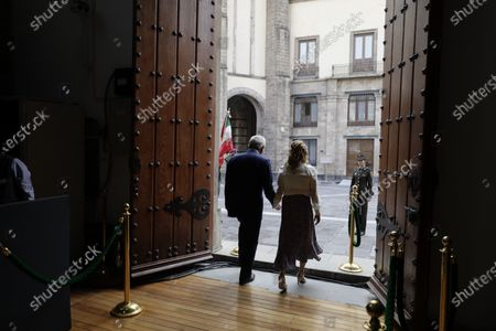 Mexican President Andres Manuel Lopez Obrador and his wife Beatriz Gutierrez leave the National Palace after a news conference to mark the 100th day of his third term in office, in Mexico City